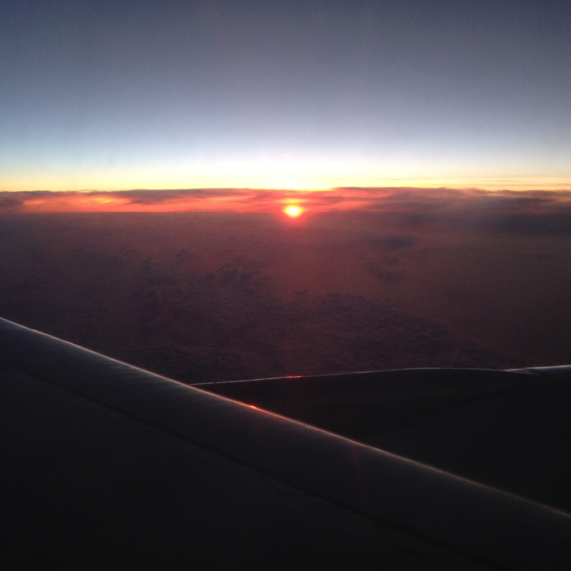 Seeing the sun rise while over the Atlantic Ocean was a first for me. Not a bad view!